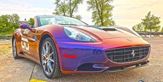 Ferrari wrapped in Avery ColorFlow Gloss Roaring Thunder Blue/Red shade shifting vinyl