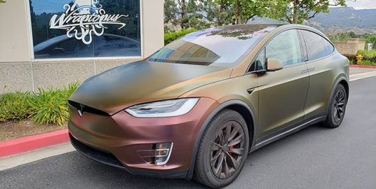 Tesla X wrapped in 3M Satin Flip Volcanic Flare shade shifting vinyl