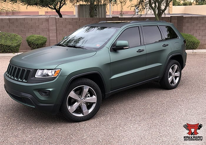 Jeep wrapped in 3M 1080 Matte Pine Green Metallic and Matte Black vinyls