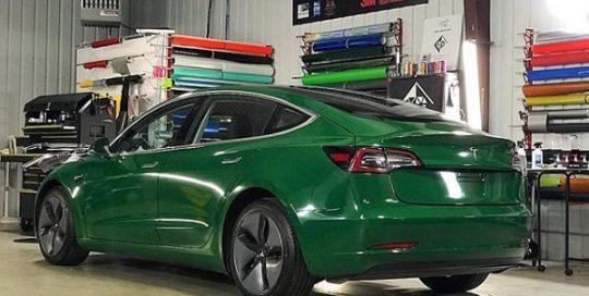 Tesla Model 3 wrapped in Avery Gloss Dark Green vinyl