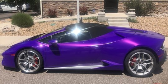 Lamborghini Huracan wrapped in 3M 1080 Gloss Plum Explosion vinyl