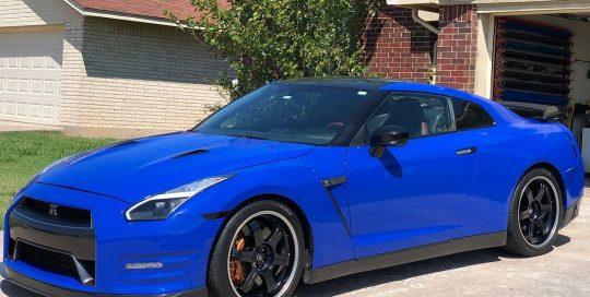Nissan GTR wrapped in Gloss Dark Blue vinyl