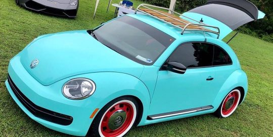 Volkswagen wrapped in Gloss Mint Blue vinyl