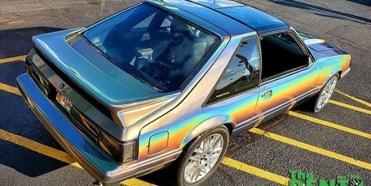 Ford Mustang wrapped in 3M Gloss Flip Psychedelic vinyl