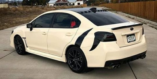 Subaru WRX wrapped in 3M 1080 Gloss Light Ivory and Gloss Black vinyls