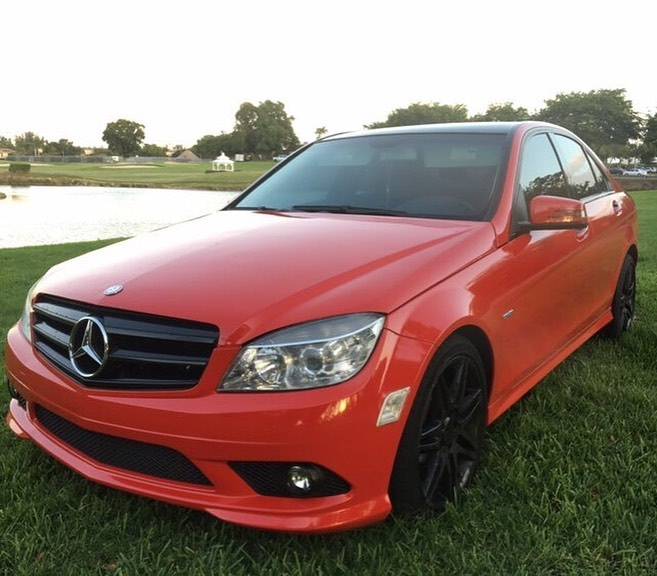 Mercedes Benz wrapped in Gloss Carmine Red vinyl