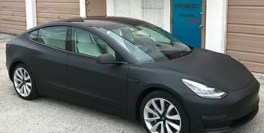 Tesla Model 3 wrapped in 3M 1080 Matte Deep Black vinyl