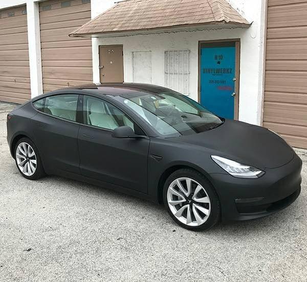 Tesla Model 3 wrapped in 3M 1080 Matte Deep Black vinyl