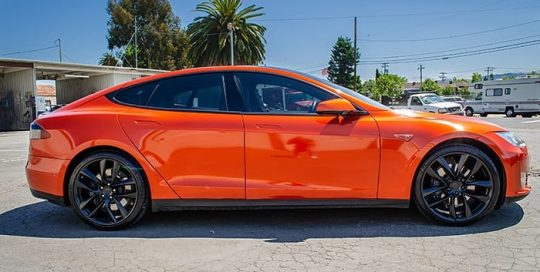Tesla wrapped in 3M Gloss Fiery Orange vinyl