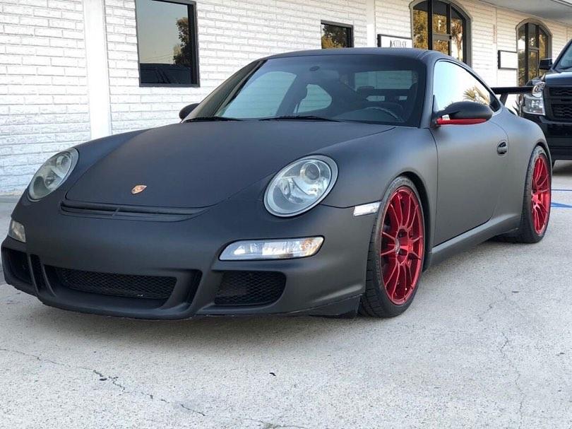 Porsche wrapped in Matte Black vinyl