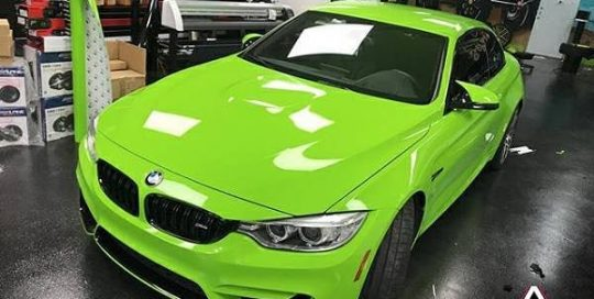Bmw M4 wrapped in 3M 2080 Gloss Light Green vinyl