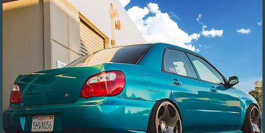 Subaru WRX wrapped in 1080 Atomic Teal vinyl